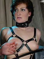 Babe in leather submits to tit torture, hot wax.