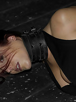 Brunette gagged, beaten and bound to a post