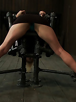 Blonde is gagged and bound on her knees in metal device