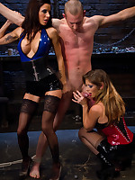 Two latex dommes punish and discourage suppress a man