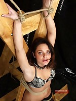 Pretty brunette slave collared, chained and bound to the cross