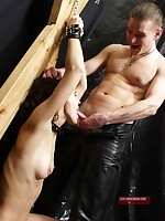 Chained submissive forced to sexually service her Master