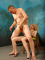 Submissive man rides his domme's strap-on in reverse cowgirl