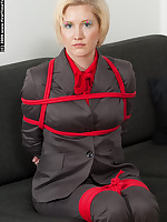 Blonde businessman bound in red rope