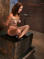 Slavegirl bound cross-legged in rope