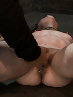Girl is tied spread-eagle, flogged and forced to cum