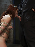 Forced blowjob for rope-bound beauty