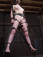 Pretty slave wears gas mask while bent double and spread wide