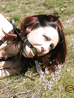 Sweet submissive is bound, gagged, abandoned in field
