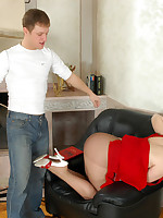 Young man earns a footjob from stocking-clad lady