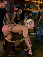 Collared blonde on hands and knees in warehouse yard