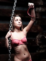 Girl in pink bikini poses with chains
