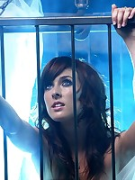 Angelic brunette confined to cage