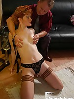 Stern Master dominates redhead in stockings with cruel spanking