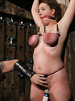 Woman bound and blindfolded with belts