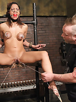 Slavegirl subjected to stocks, flogging, breast and clit pump