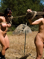 Strenuous outdoor training of two slavegirls