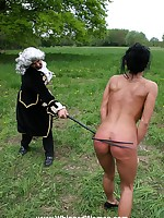 Outdoor whipping for naked slut