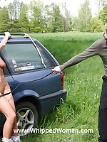 Woman is tied to a car and whipped in a field