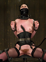 Amanda earns her coarse rider call on by enduring a rope only suspension, harsh gagging, intensive caning, expandible latex hoods and amazing orgasms.