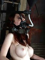 She's hooded plus shackled.