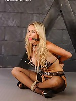 Sexy blond Lucy Zara ball gagged plus unostentatious in fishnet nylons plus skimpy undergarments
