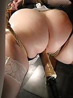 Corsetted Claire is bound and drilled with a cock not susceptible a pole