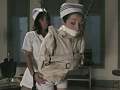 Girl in straightjacket is beaten and shocked