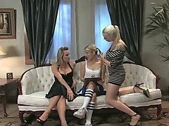Two Dommes torment a cheerleader