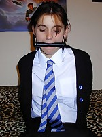 A Schoolgirl is horsegagged and bound