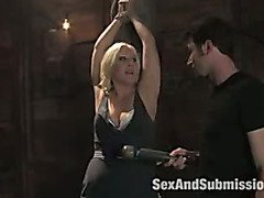 Beautiful blonde submits in bondage.