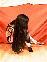 Girl takes a very hands-on approach with her captive