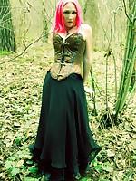 Elyssia cuffed in the woods