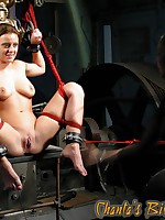 Submissive girl on the stretching rack receives forced orgasms