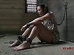 Brunette held captive in a barn with chains