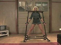 Mistress locks blonde slave into the stocks