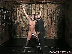 Brunette in bondage forced to cum.
