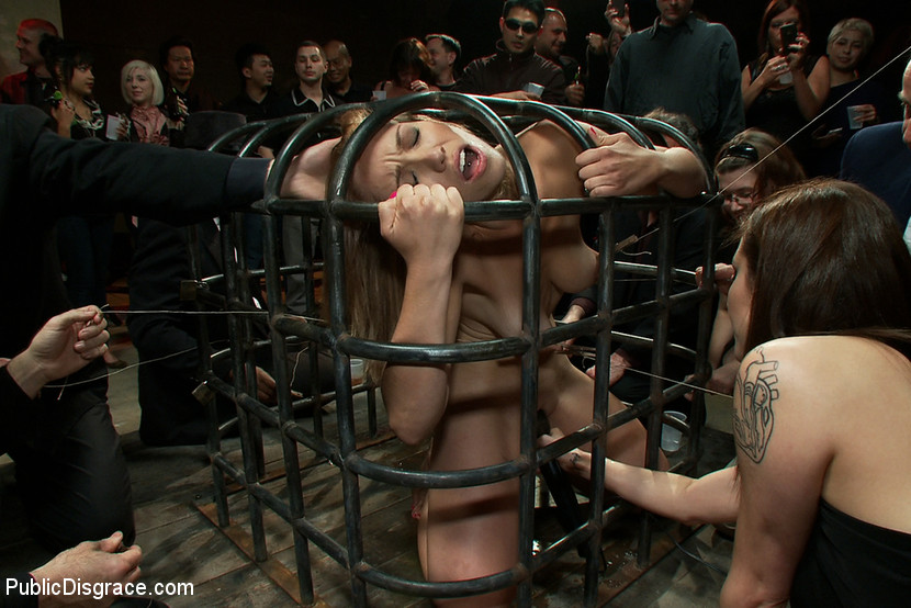 Naked women slaves in cages