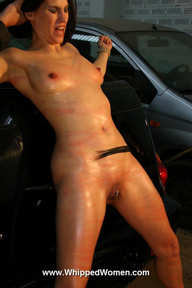 Naked women whipped