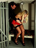 Lashing of busty blonde inmate