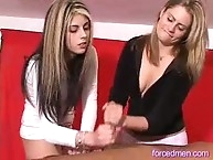 Two sexy lady smooth cock hand job
