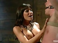 Gorgeous dominatrix locks slaveboy up