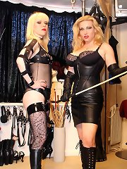 Two mistresses in high heels dominated slaveboy