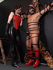 The slave is soaked in oil before receiving a thorough thrashing from his Mistress