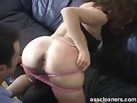 Domme bows over whilst man is on his knees to take up with the tongue ass