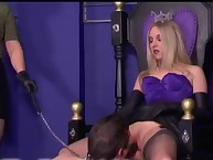 The cruel mistress sits on a slave boy