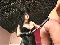 Mistress spanks slave