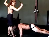 Female sexy corporalist in a dark dress