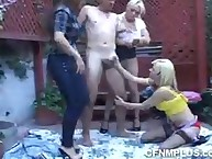 Dressed girls demean a naked dude