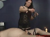 Electrocuting a slave's cock increased by balls